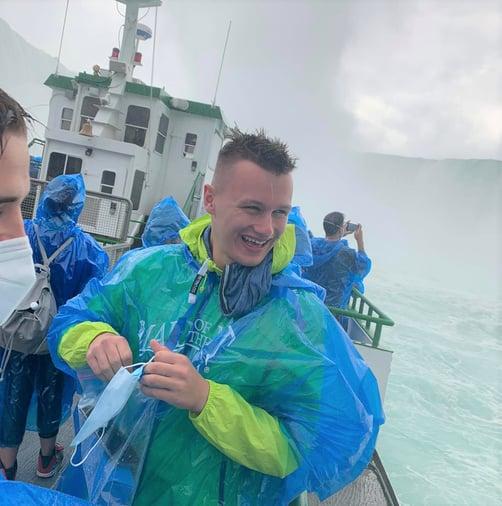 Nicolas in rain poncho in front of Niagara Falls