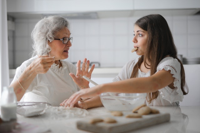 grandmother and grandaughter making cookies together