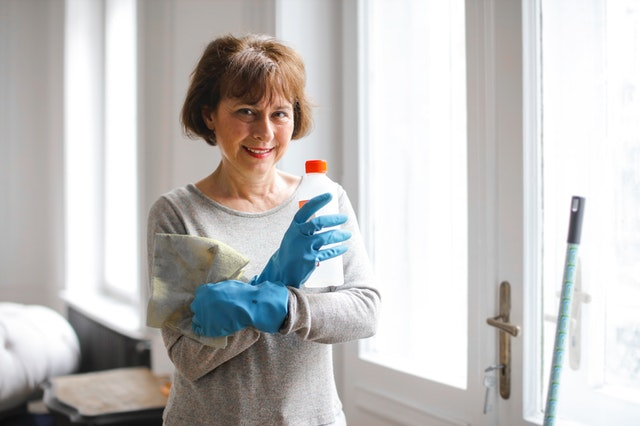 a cleaning woman smiles for the camera