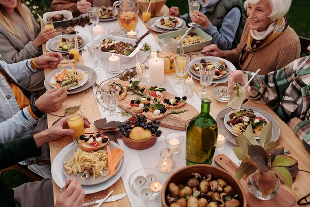 family eating Italian food around large table