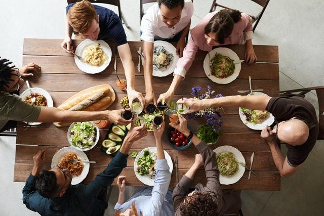family toasting around dinner table