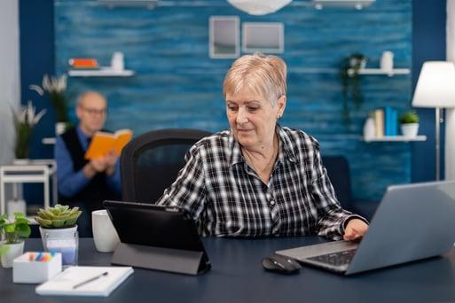 senior woman working at computer