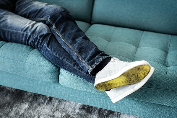 wearing shoes on the couch/carpet