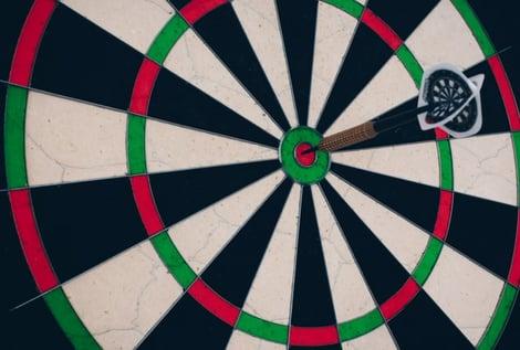 dart board with dart hitting the target