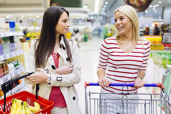 two women talking at grocery store