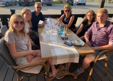 teenage american girl with Germany host family at restaurant