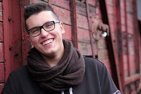 teenage boy is smiling to illustrate talking about culture shock