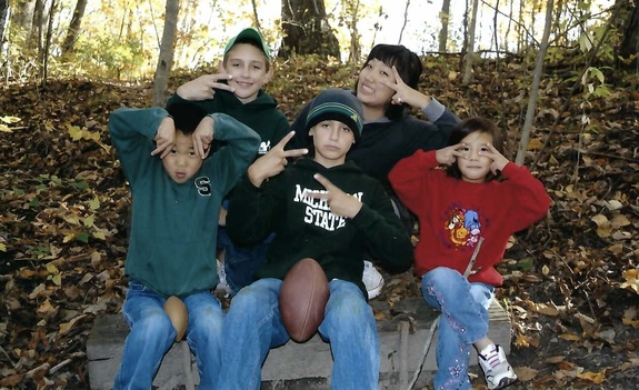 three brothers with little sister and exchange student from Korea in the forest
