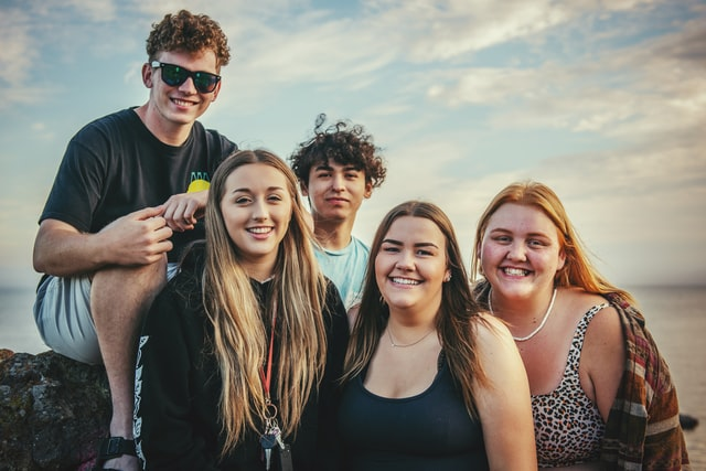 a group of smiling teenagers