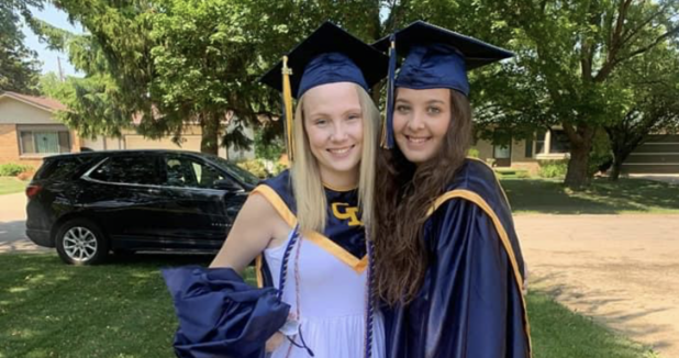 two teenage girls in graduation caps and gowns