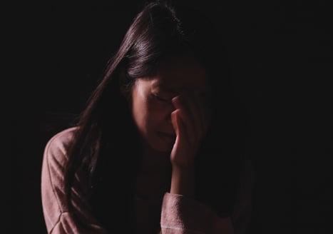 teen girl crying in the dark