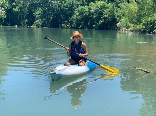 young girl in kayak in lake